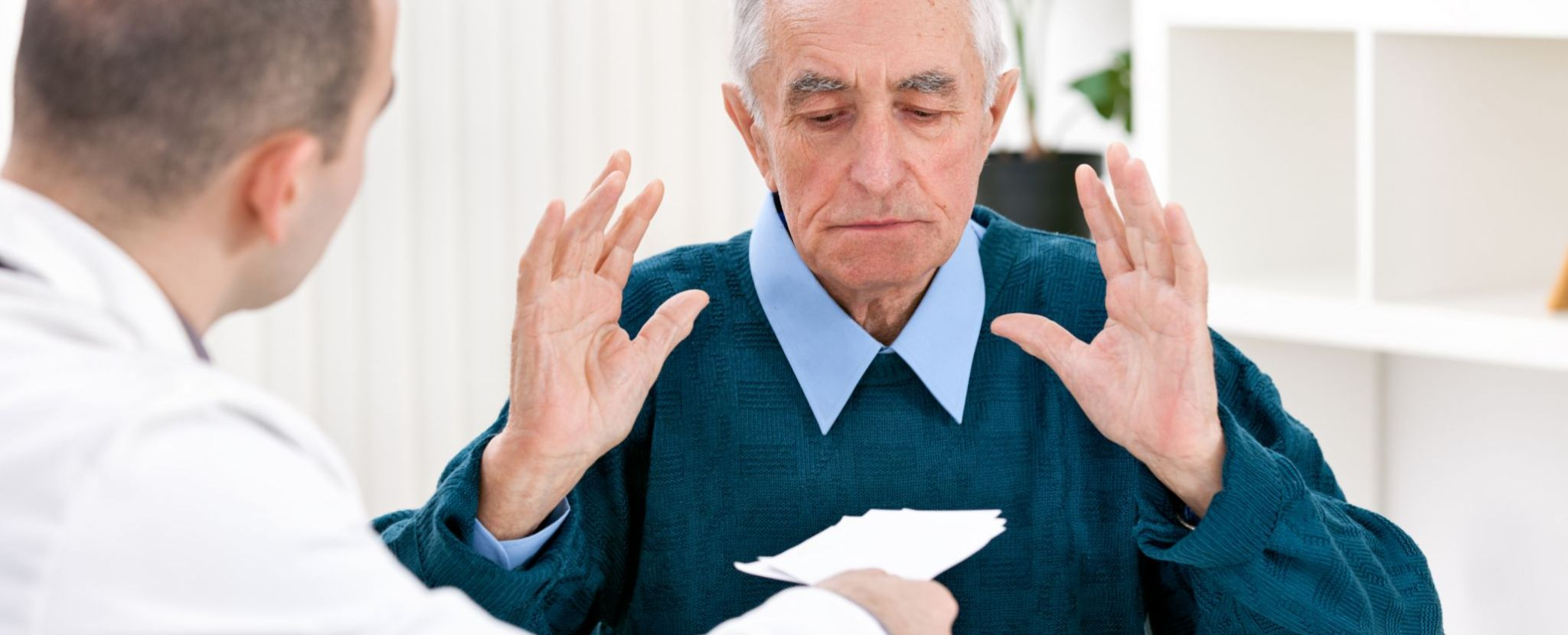 senior man refusing prescription
